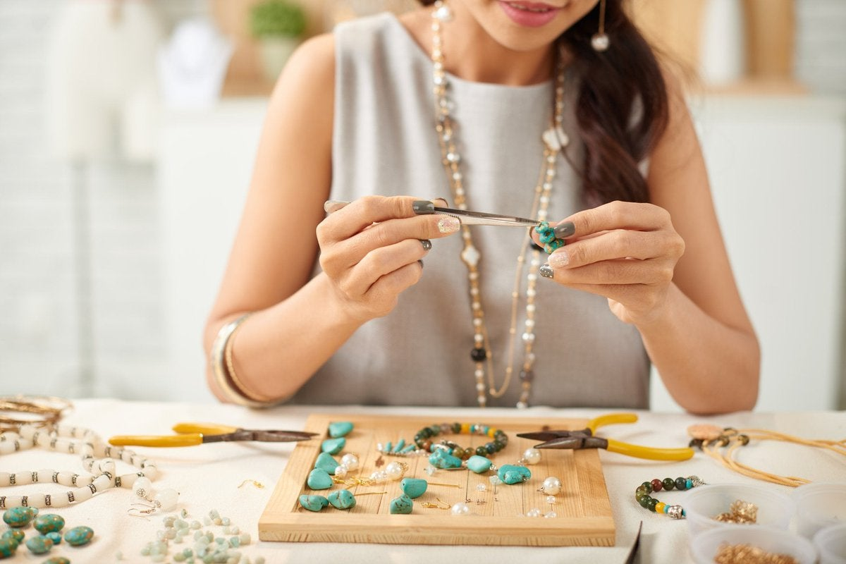 Woman hand crafting jewelry.