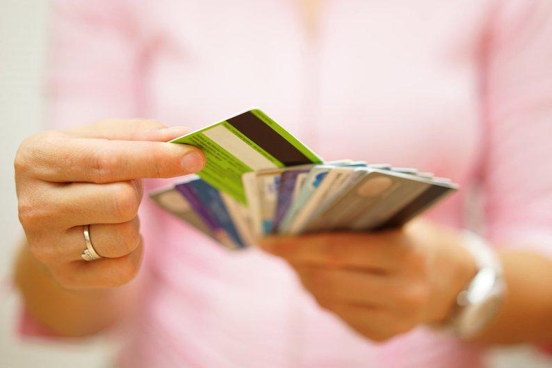 woman selecting credit card