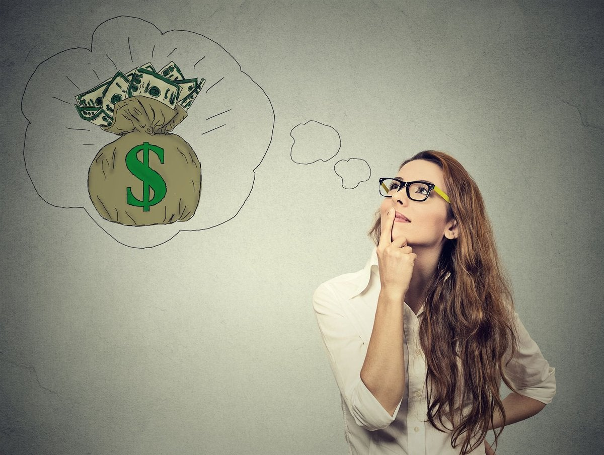 young woman with her hand under her chin standing beneath an illustrated thought bubble containing a bag of cash