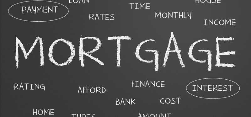 Blackboard with the word mortgage and smaller related words around it.