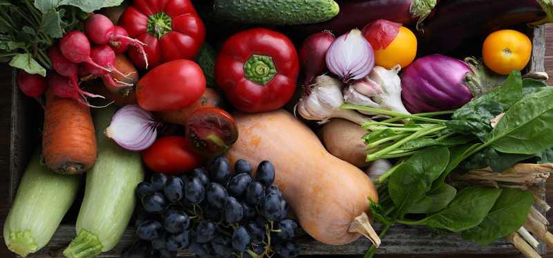 A bin full of fresh vegetables.