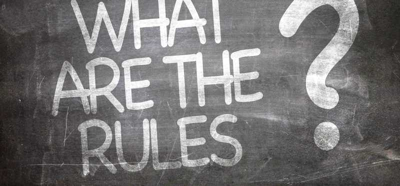 What are the rules written in chalk on a blackboard.