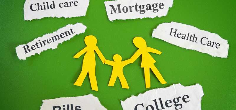 Yellow paper cutout family on green background surrounded by words about costs of living.