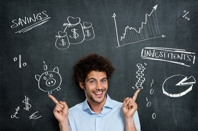 Man in front of blackboard with investing-related pictures and words drawn on it