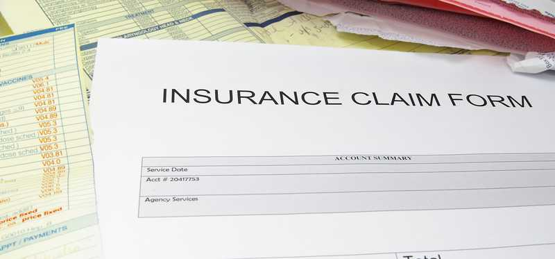 A paper insurance claim form.