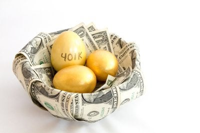 Basket lined with money holding golden eggs that read 401k.