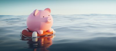 Piggy bank on a life preserver in open water.