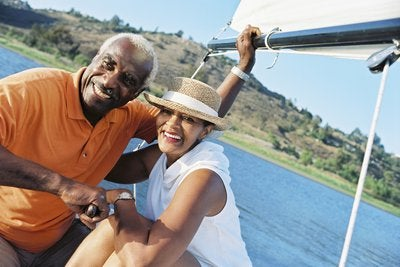 A wealthy senior couple enjoying retirement while on their sailboat