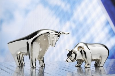 A metal figurine bull and bear face off.