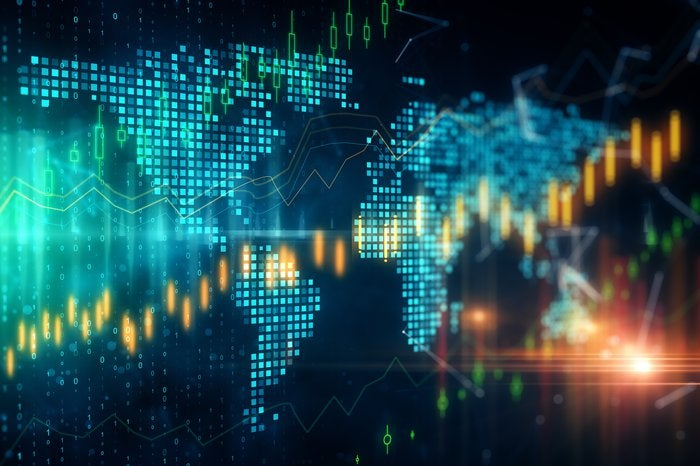 A digital world map with superimposed rising stock graphic