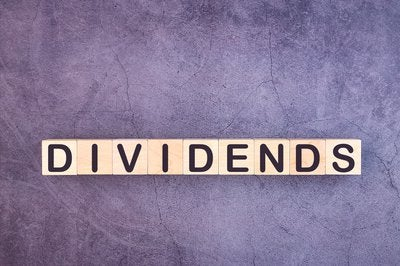 Dividends spelled out in wooden blocks