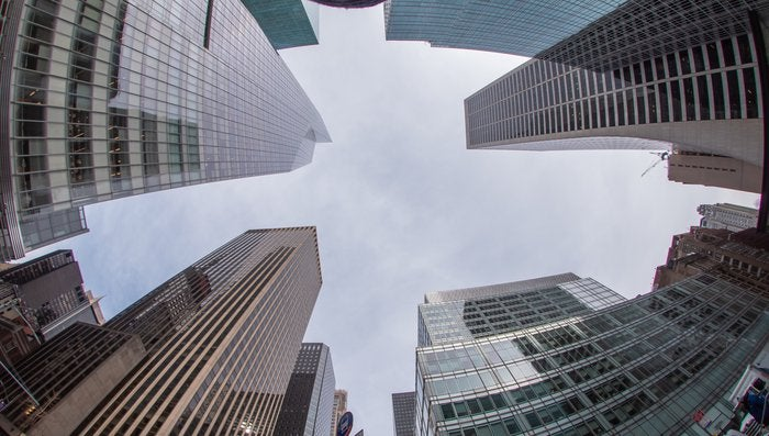 Bank of America Tower in Midtown Manhattan and surrounding buildings, wide angle upward view, New York City