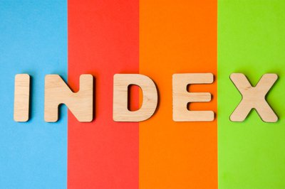 The word Index against a background of colored stripes