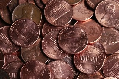 We see a picture frame fully filled with pennies.