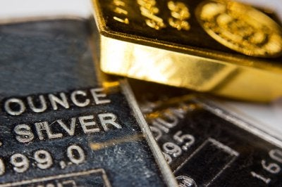 Gold and silver bars laid messily next to one another.