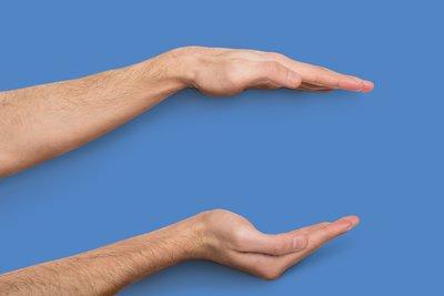 Hands measuring distance between them