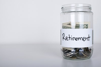 jar labeled retirement and half-filled with cash and coins