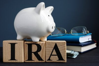 IRA letters with piggy bank book and glasses.