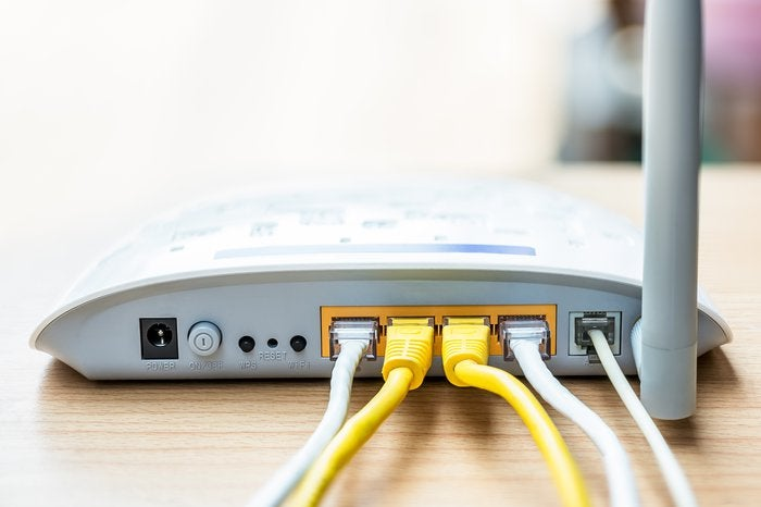 An internet modem with cables attached