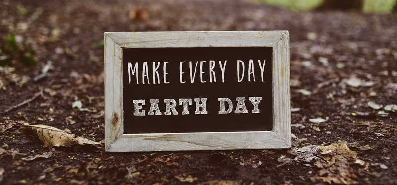 Make every day earth day sign outside in the dirt.