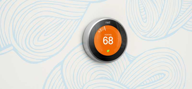 A Nest thermostat on a wall.