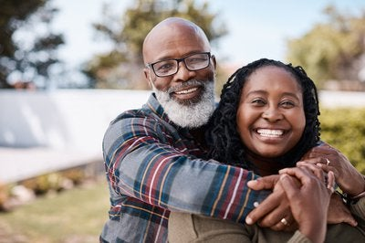 Older Black Couple Embracing and Smiling