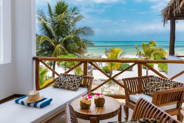 View from the balcony of a resort on the beach.