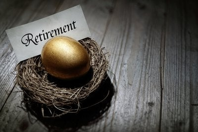 A golden egg in a nest with a sign reading Retirement