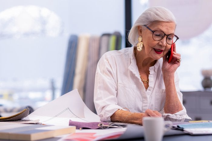 Senior woman working and talking on phone