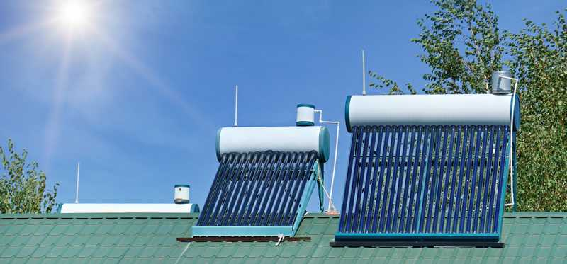 Solar water heaters installed on a roof.