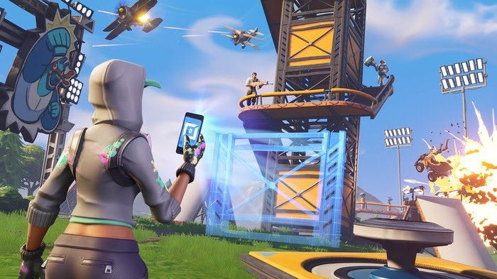 Tencent Holdings character using cell phone to light a path during an outdoor battle