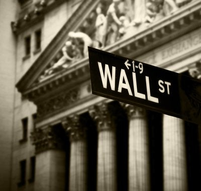 A close up black and white photo of the Wall street sign.