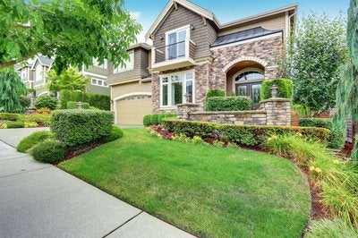 Beautiful new home with nice green lawn.