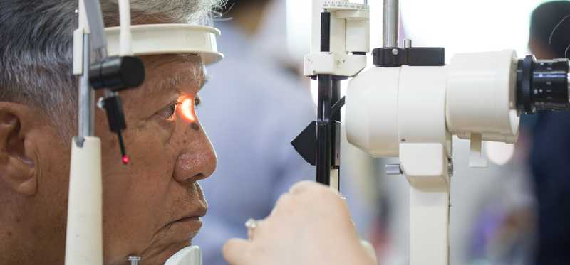 Older man getting his eyes examined.