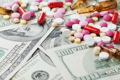 Pills scattered on top of money