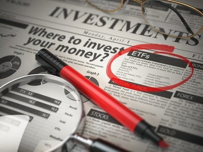 Newspaper article about investing in ETFs circled with red marker.
