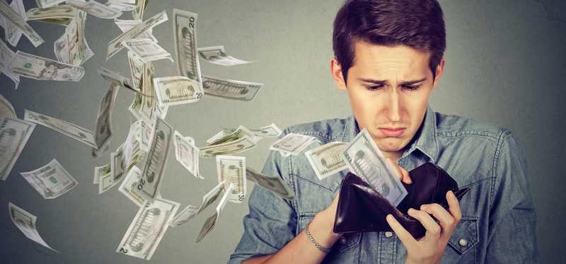 young man with money flying out of wallet