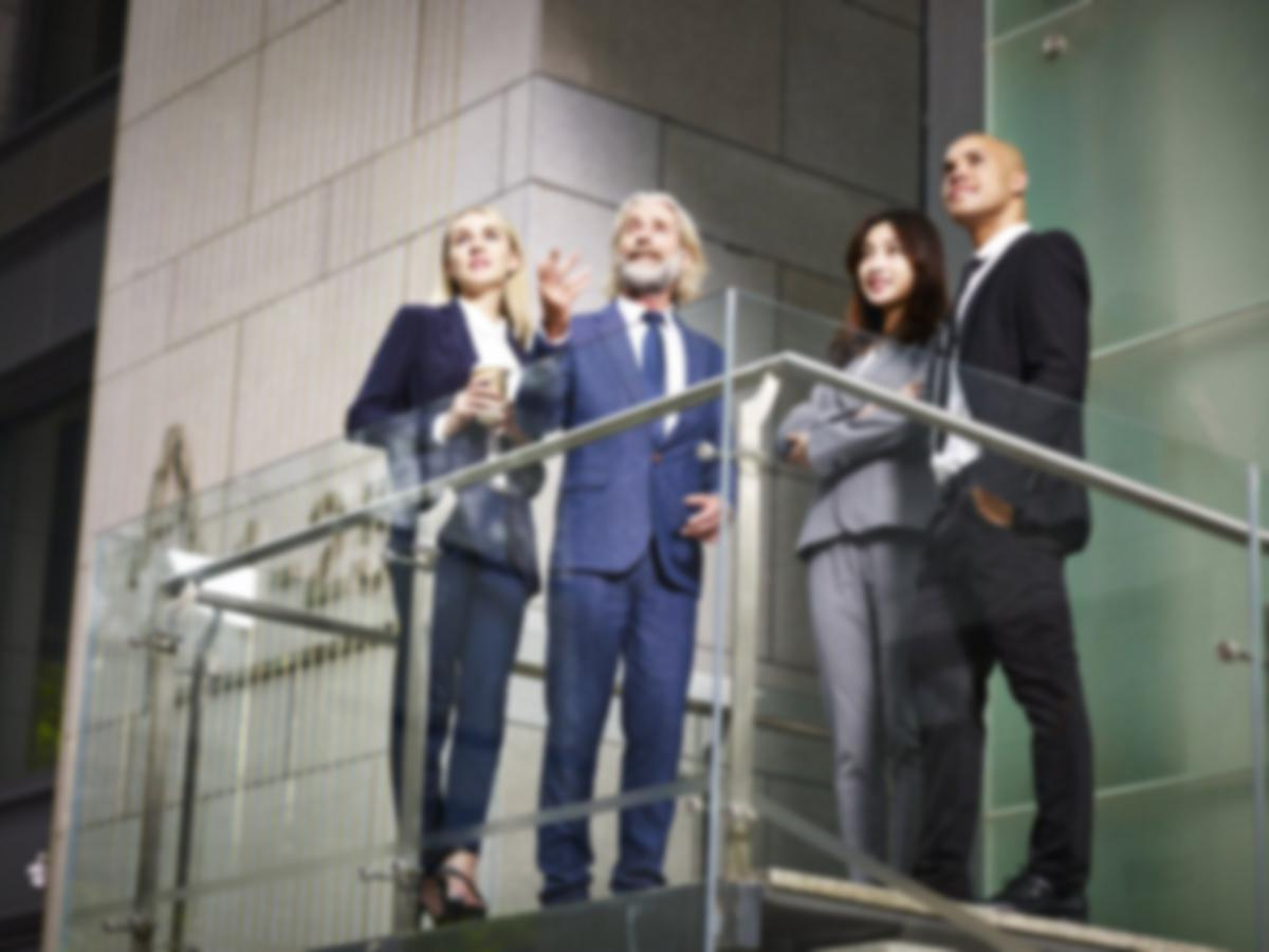businesspeople looking at a property