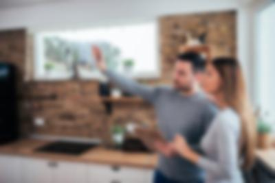 couple looking at a kitchen