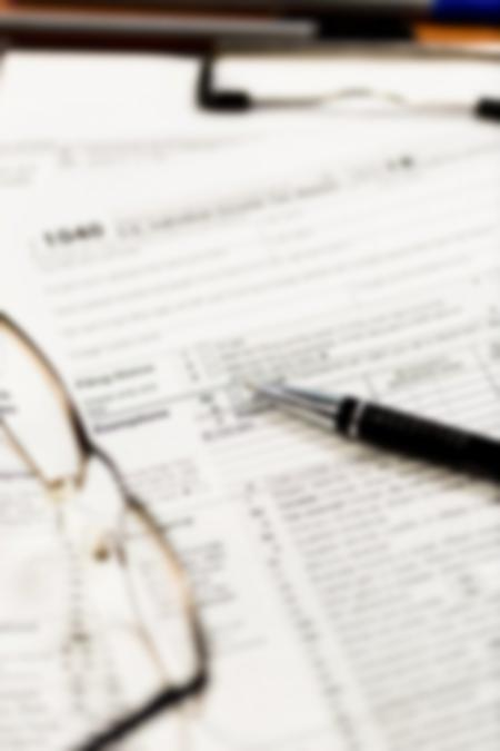 glasses with tax forms
