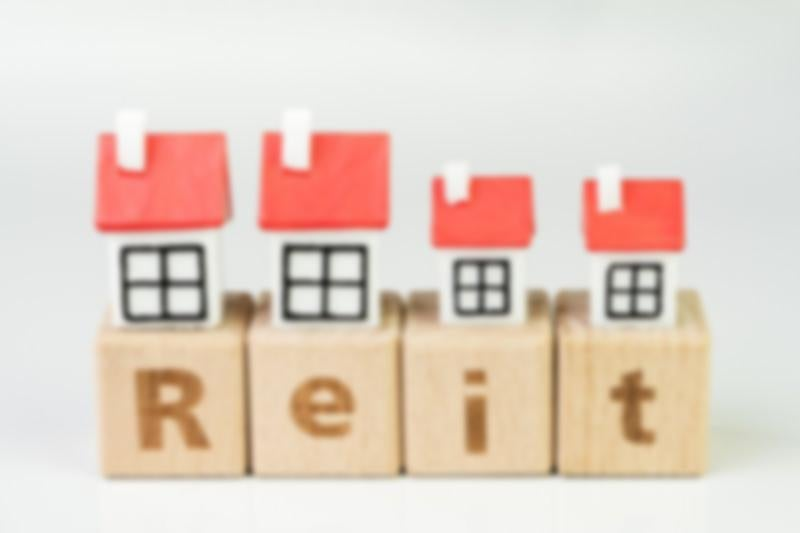 Blocks showing the word REITs