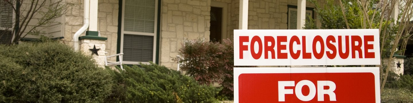 house with a foreclosure sign