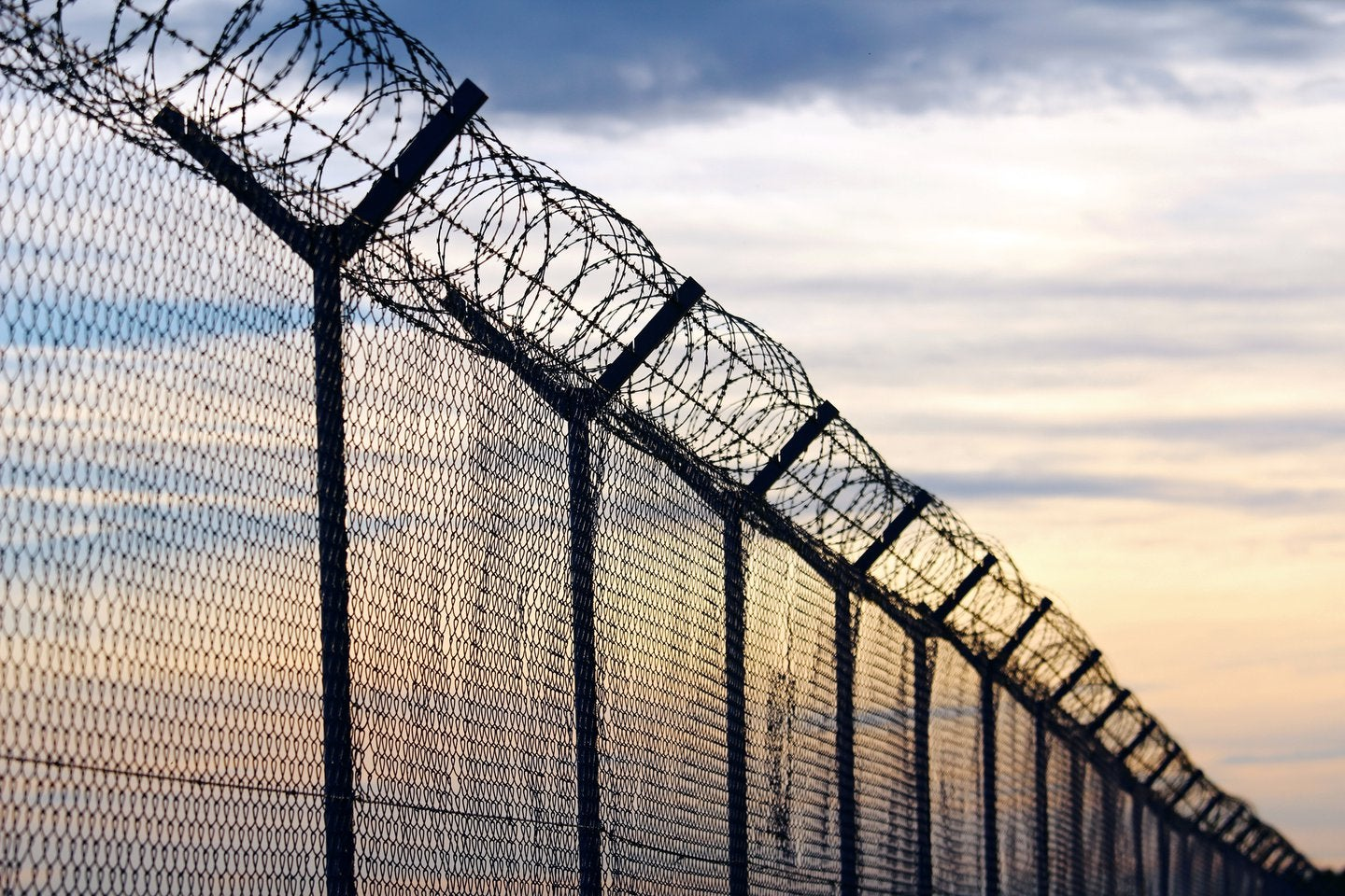 prison wall with barbed wire