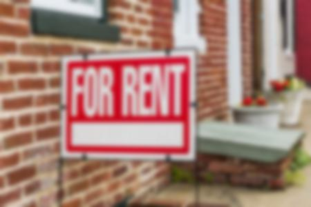 for rent sign in front of brick building
