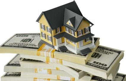 model house on a stack of money