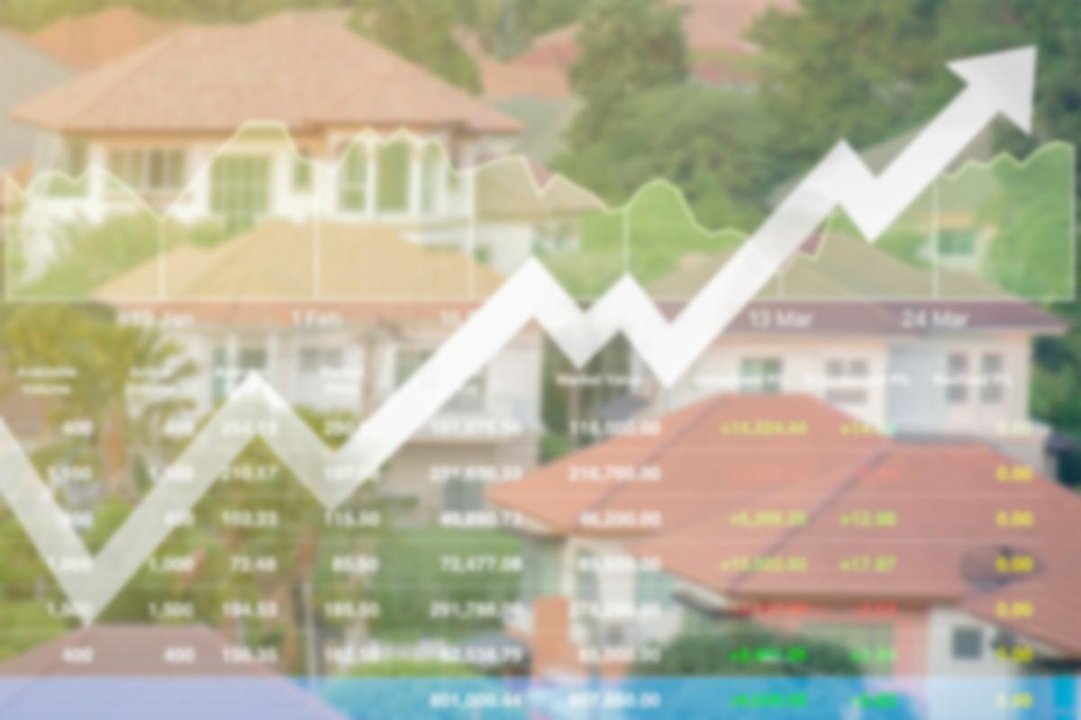 financial chart superimposed over a house