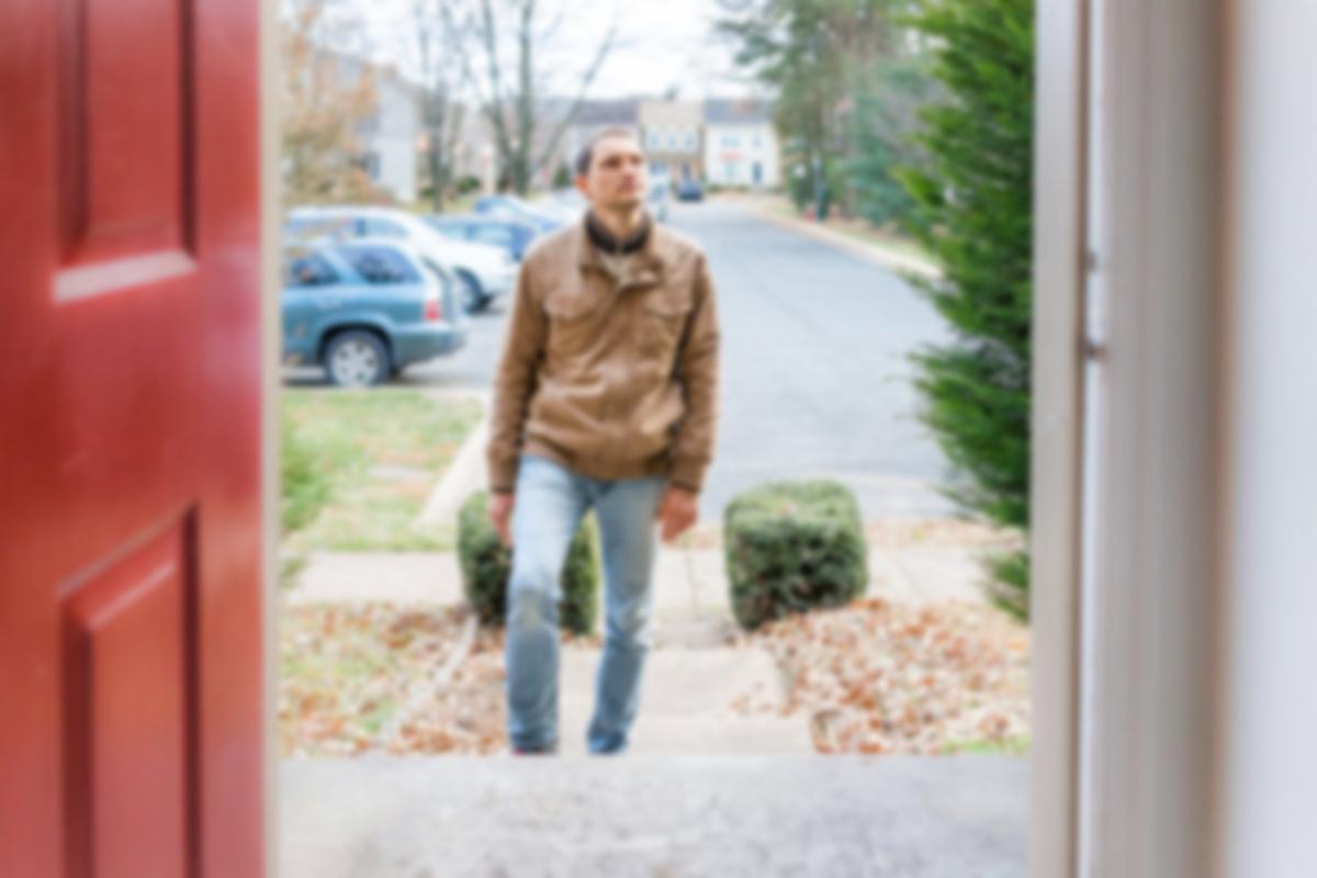 man looking at door