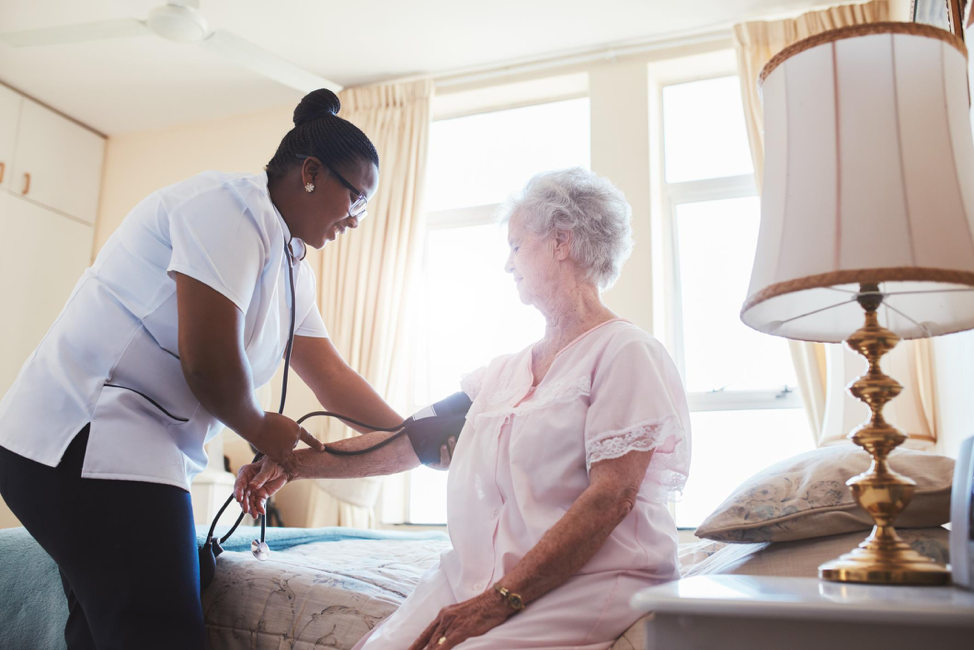 Healthcare Providing Help To An Elderly Individual