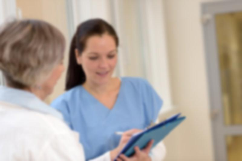 Nurse talking with older woman