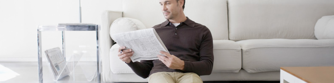 man looking at newspaper